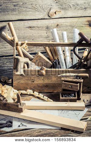 Antique Carpentry Workbench On Old Wooden Table