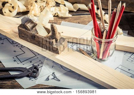Antique Carpentry Workbench With Tools On Old Wooden Table
