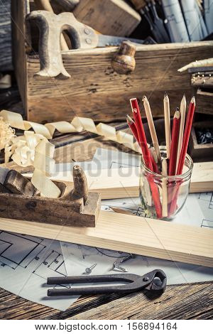 Vintage Carpentry Workbench And Drawing Workshop On Old Wooden Table
