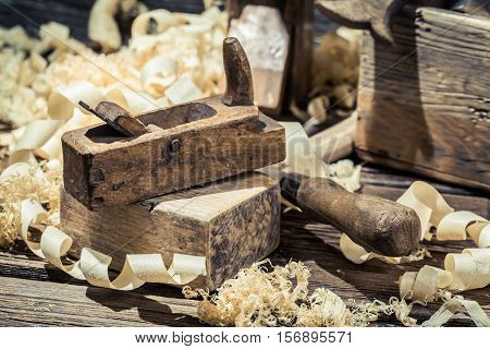 Planer, Piece Of Wood And Sawdust On Old Wooden Table