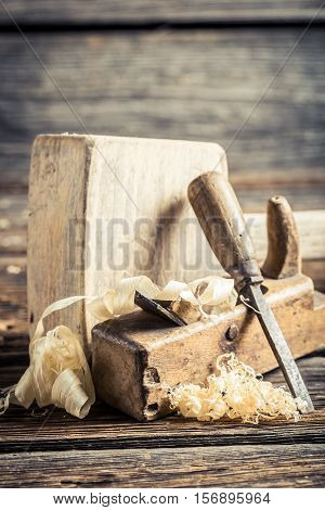 Wooden Hammer And Planer On Wooden Table