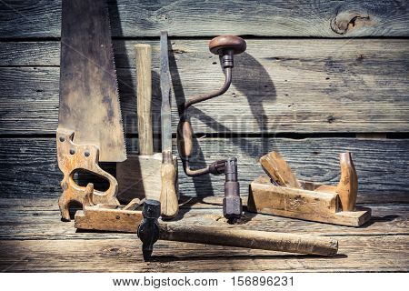 Hammer, Saw And Chisel On Carpentry Workbench