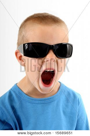 Little boy wearing sunglasses and singing