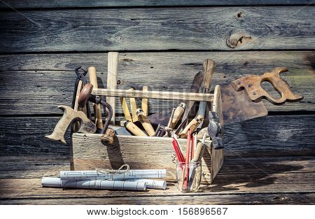 Hammer saw and paper scheme in the carpentry toolbox poster
