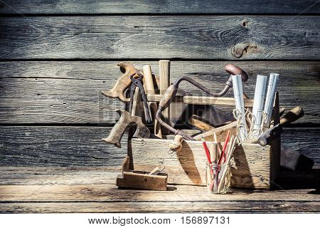 Vintage Carpenter Tools In A Toolbox On Old Wooden Table