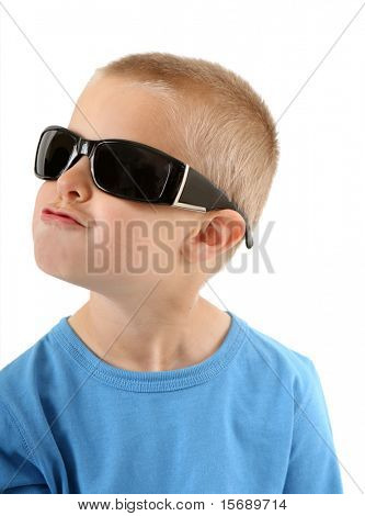 Little boy in sunglasses singing