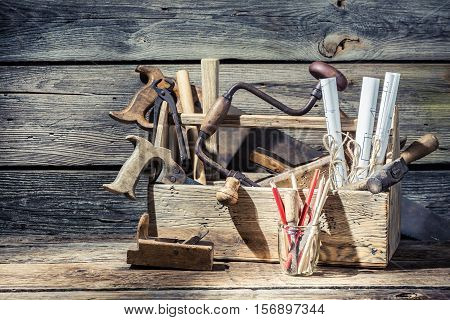Technical Diagrams And Carpentry Vintage Toolbox On Old Wooden Table