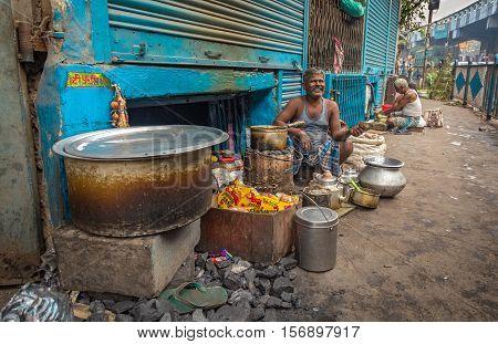 A roadside tea seller selling morning tea for commuters on the pavement of Strand Road, Kolkata, India on November 14, 2016.