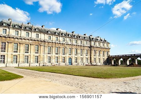 Château de Vincennes. Is a massive 14th and 17th century French royal fortress in the town of Vincennes, to the east of Paris, now a suburb of the metropolis. Paris, France