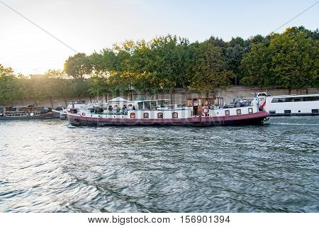 PARIS, FRANCE, April 25, 2016. A Barge on the Seine in Paris. It is very common to see these beautiful boats that serve as housing on the Seine River in Paris