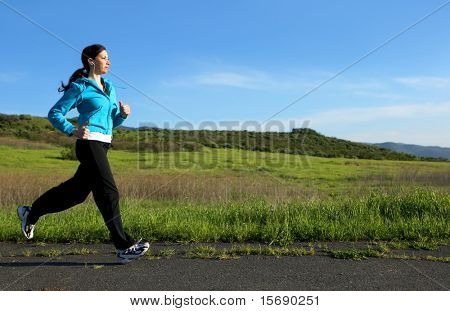 Young woman running on a trail