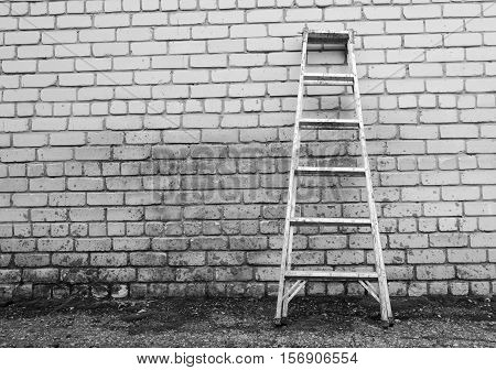 Metal ladder on a spotty wall backgrounbd