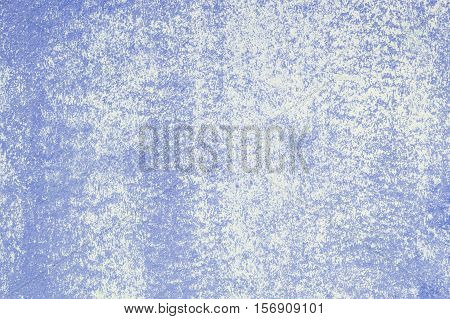 Closeup pale color and peeling of painted blue cement wall textured background