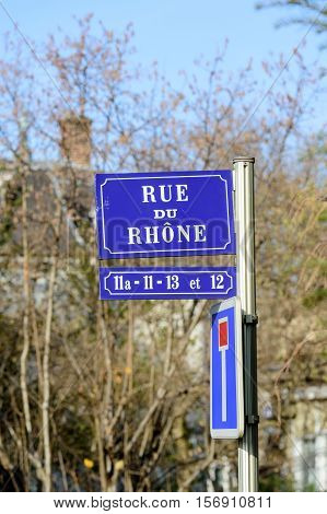 Rue du Rhone translated as Rhone street with blue house number indicators seen in French city of Mulhouse Alsace France