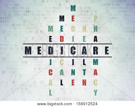 Medicine concept: Painted black word Medicare in solving Crossword Puzzle on Digital Data Paper background
