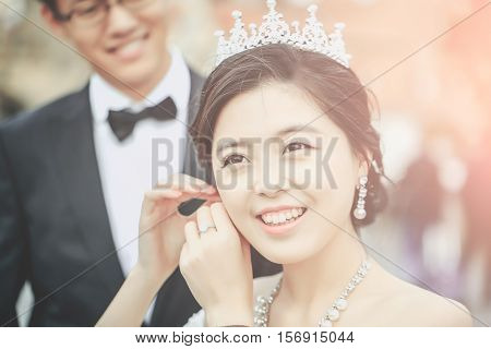 Pretty Bride Puts On Earring