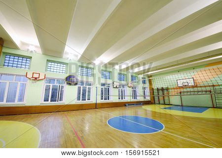MOSCOW, RUSSIA - JUN 28, 2016: Gym with volleyball net, basketball hoops in 2107 school, In Moscow there are more than 1800 schools