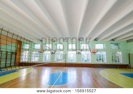 MOSCOW, RUSSIA - JUN 28, 2016: Gym with volleyball net in 2107 school, In Moscow there are more than 1800 schools