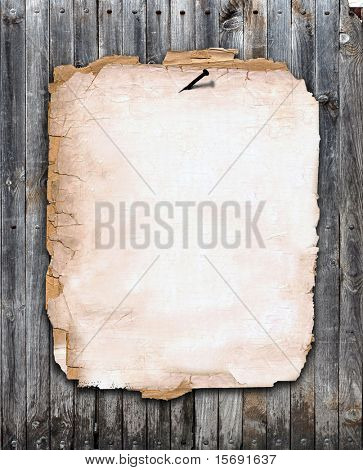 Old paper nailed to a wood fence, room for copy