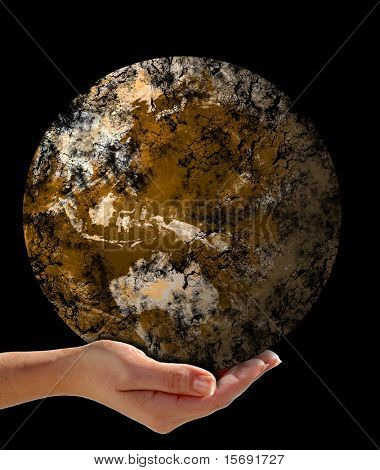 Hand holding a dead crumbling Earth