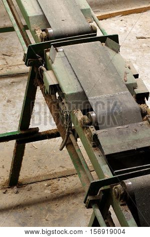 Conveyer belt manufacturing line wood industry theme.