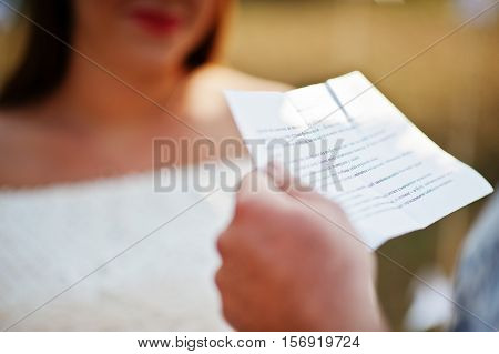 Man Read Vows From Paper For His Pregnant Woman And They Future Baby At Ceremony Background White Ar