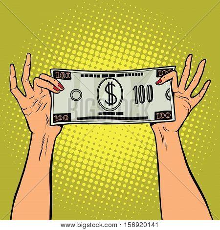 Female hands holding a hundred dollar bill, pop art retro vector illustration