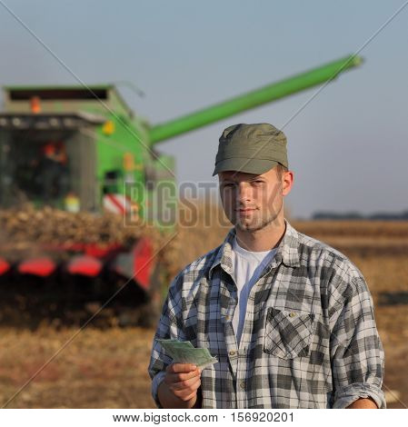 Agricultural Concept, Farmer, Money And Harvest