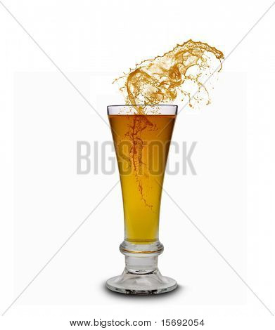 Beer splashing out of a glass