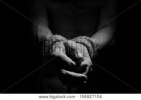 Man with a rope tied his hands