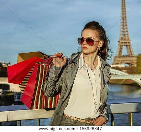 Fashion-monger With Shopping Bags Looking Into Distance, Paris