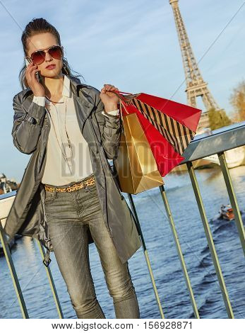 Fashion-monger With Shopping Bags Speaking On Mobile In Paris