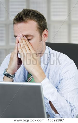 Frustrated business man concerned with finances