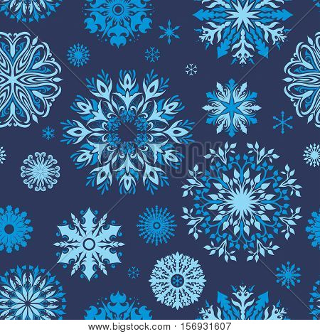 Seamless winter christmas texture with ornamental snow on blue background for new year design