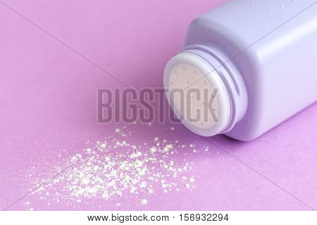 baby powder on purple background close up