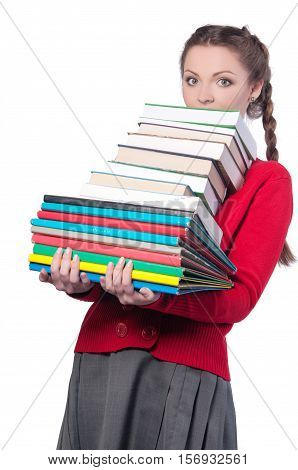 young girl standing with a bunch of books on an isolated background