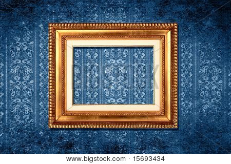 Vintage gold frame on blue grungy victorian wallpaper