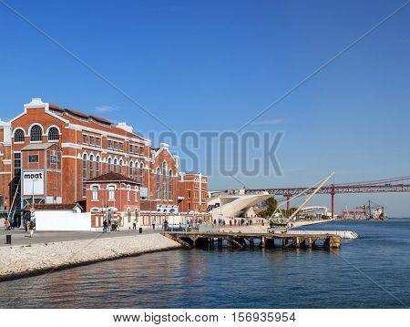 Lisbon, Portugal. October 31, 2016: Central Tejo, historical power plant and Electricity Museum with the MAAT, the new museum, in background.