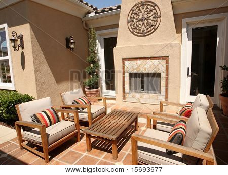 Contemporary outdoor patio with fireplace