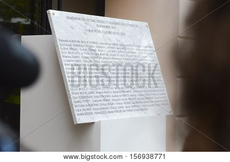 Paris, France - November 13, 2016:  Memorial stone with 90 names of victims at the Bataclan tribute to the victims of the attacks