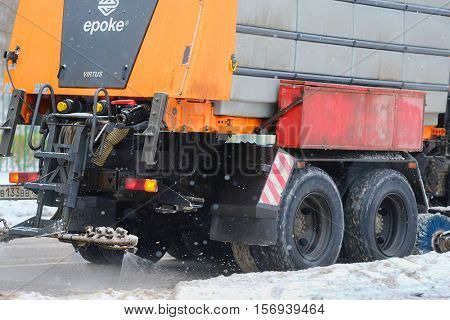 Moscow, Russia - November, 12, 2016: Snow removal machine on a snow-covered road after high snow-storm in Moscow, Russia