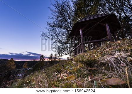 Wooden lookout over city at sunset. Moravian landscape Lysice.
