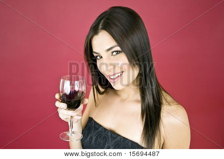 Beautiful woman drinking a glass of red wine