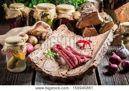 Homemade Thin Sausages In Pantry On Old Wooden Table