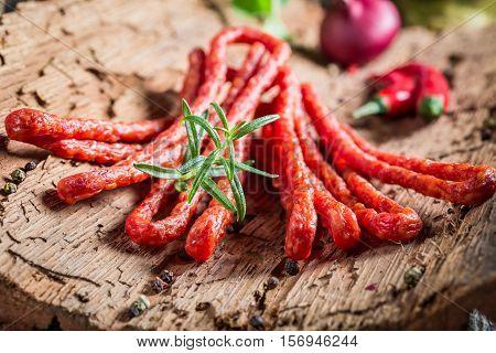 Tasty Kabanos Sausages In Rural Storeroom On Bark