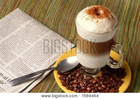 Capuccino Spoon And News
