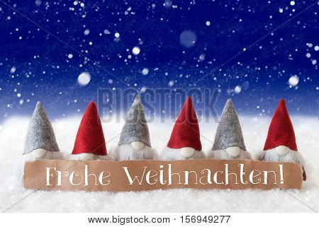 Label With German Text Frohe Weihnachten Means Merry Christmas. Christmas Greeting Card With Gnomes. Blue Background With Snowflakes