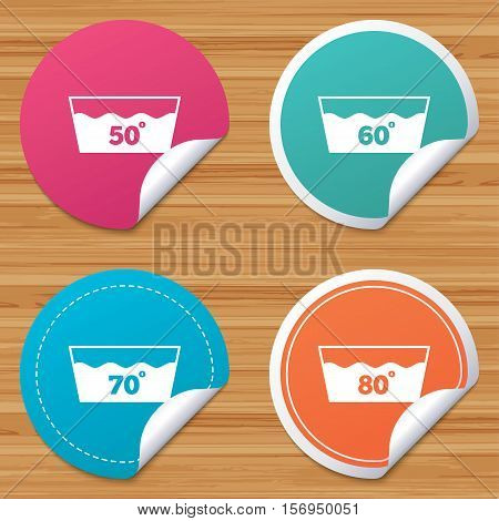 Round stickers or website banners. Wash icons. Machine washable at 50, 60, 70 and 80 degrees symbols. Laundry washhouse signs. Circle badges with bended corner. Vector