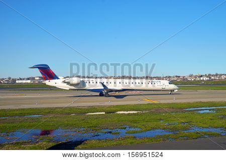 NEW YORK - APRIL 05, 2016: airplane at LaGuardia Airport. LaGuardia Airport is an international airport located in the northern part of Queens, New York City.
