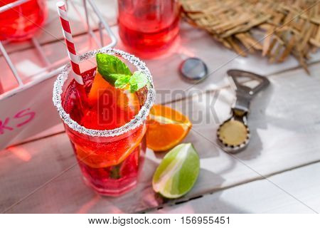 Cold Summer Drink With Mint Leaf On Old White Table